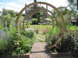 round pergola for striking garden design creating peaceful