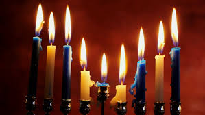 hanukkah candles colors burning candle on the background of christmas light