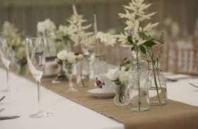 Wedding Flowers Table Long Tables With Hessian Runners And Bottles In Marquee Country