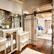 a charming bathroom with wooden flooring and sliding door also