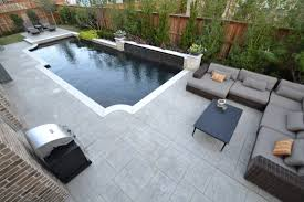 trophy club contemporary pool with slate water wall