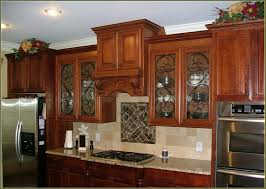 Kitchen Glass Cabinets by White Kitchen Features Open Shelving Filled With Pottery Over A A