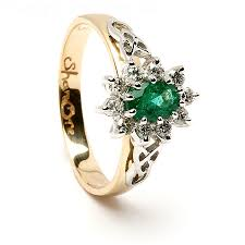 celtic engagement rings oval emerald with diamond cluster celtic engagement ring