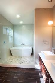 this contemporary bathroom features a spa like wet room with a