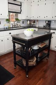black stained wooden movable kitchen island with two tier shelves