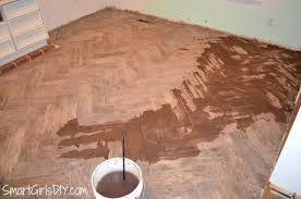 grouting a herringbone tile floor family room 11