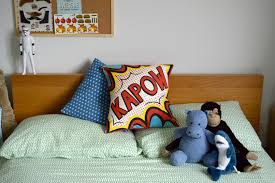 my boy u0027s room styling with a comic book cushion from coconutgrass