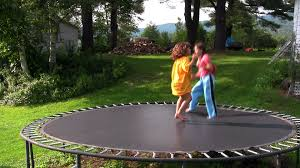 Trampoline Backyard Kids Jump And Play On The Trampoline In The Backyard Stock Video