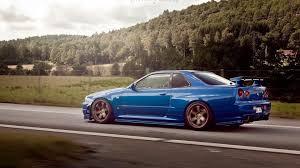 blue nissan skyline nissan nissan skyline skyline r34 gtr car machine blue blue road