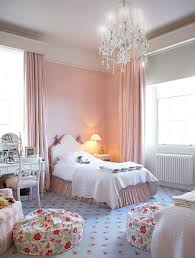 classic chandelier visually complements the painted ceiling of the awesome shabby chic bedroom with glittering chandelier ideas