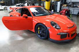porsche cayman orange lava orange porsche 991 gt3 roll bar install at bbi autosport