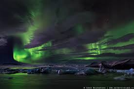 what creates the northern lights northern lights aurora borealis in iceland guide to iceland