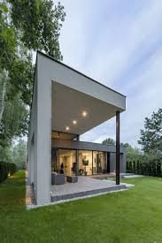covered outdoor seating one and a half story family house in poland paints a picture of