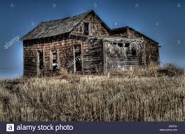 hdr photo of abandoned old weathered rustic rural house with