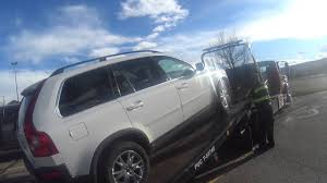 volvo semi dealer transporting the broken down volvo xc90 to the rickenbaugh volvo