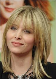medium layered hairstyles for women over 50 haircuts with bangs elegant medium length layered hairstyles with