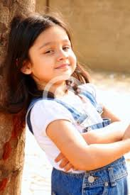 Small girl child photographed in daylight looking cute and sweet