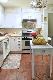 what color hardware for white kitchen cabinets white painted kitchen cabinets with brass hardware