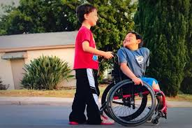 8 year helps buy new wheelchair for his best buddy when