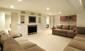family room with sectional and fireplace luxurious interior of good basement design ideas with sectional
