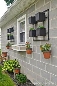 design a concrete wall with hanging flower pots using hangapot design a concrete wall with hanging flower pots using hangapot hangers