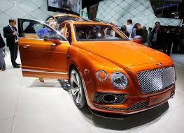 orange bentley bentayga frankfurt germany luxury automakers roll out powerful suvs at