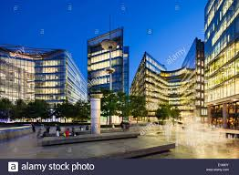 london glass building night view of several modern glass buildings near city hall in