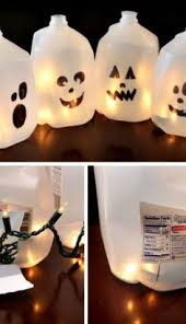 Recycled Halloween Crafts - make halloween luminaria by filling milk jugs with lights fall
