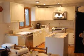 kitchen elegant restaining cabinets with silver refrigerator and