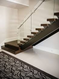 luxury residential open rise contemporary stair design featuring luxury residential open rise contemporary stair design featuring an elegant glass and stainless steel handrail