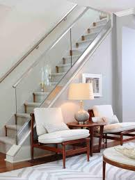 photos hgtv glass enclosed staircase above stylish gray sitting