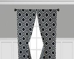 black geometric curtain panels tear drop trellis panels window