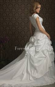 white taffeta ball gown wedding dress with lace skirt bottom and