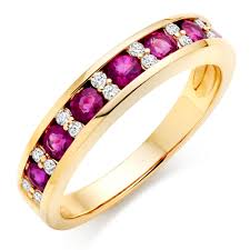 ruby eternity ring 18ct gold diamond and ruby half eternity ring 0000056