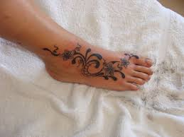 tribal butterfly tattoo on foot 2015