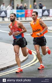 Partially Blind Partially Blind Runner With Guide Running At The 2015 Virgin Money