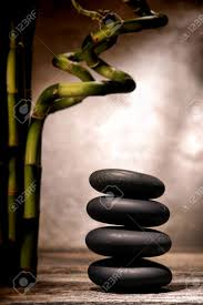 zen inspiration polished smooth black massage stones stack in a zen