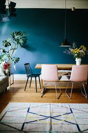 ink blue dining room walls blush pink dining chairs wood