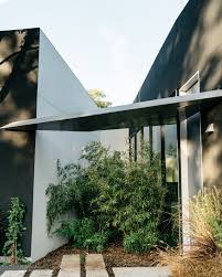 the house dallas photo 5 of 17 in a black stucco home in dallas is surrounded by eye