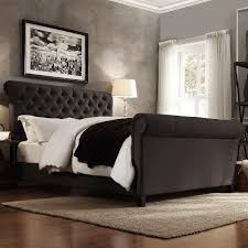 set coziness with exquisite tufted sleigh bed design