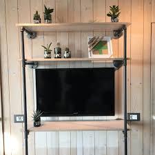 tv rack steel pipes industrial design hotel room tv rack