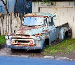 Vintage Ford Truck Junk Yards - rusted blue vintage pickup truck stock photo picture and royalty