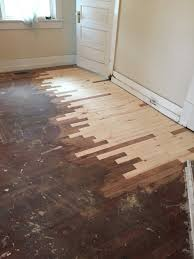 the grime and paint have been sanded away from the hardwood floors