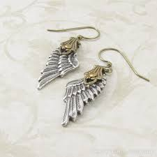whispers earrings angelic whispers dangle earrings silver angel wing earrings by