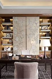chinoiserie wallpaper sliding panels over bookshelves recent