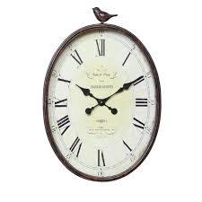 Wall Clock 25x17 Metal Oval Bird Wall Clock Shades Of Light