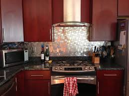 kitchen backsplash with brushed stainless steel tiles matching