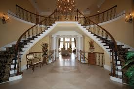 love the dual staircase in the entrance foyer of this beautiful