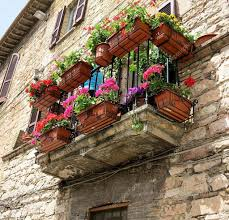 colorful flowers on balcony in medieval assisi u2014 stock photo