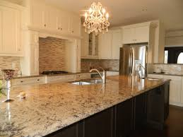 kitchen a remodeled kitchen with slab of granite island matching